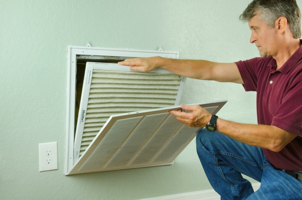 man fixing vents