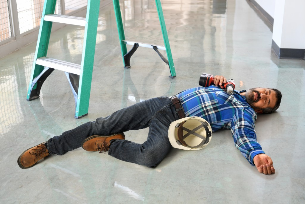 Employee lying on the floor due to an accident