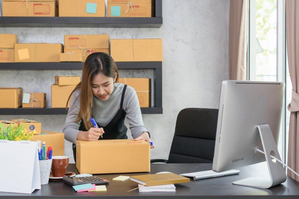 Woman signing a box
