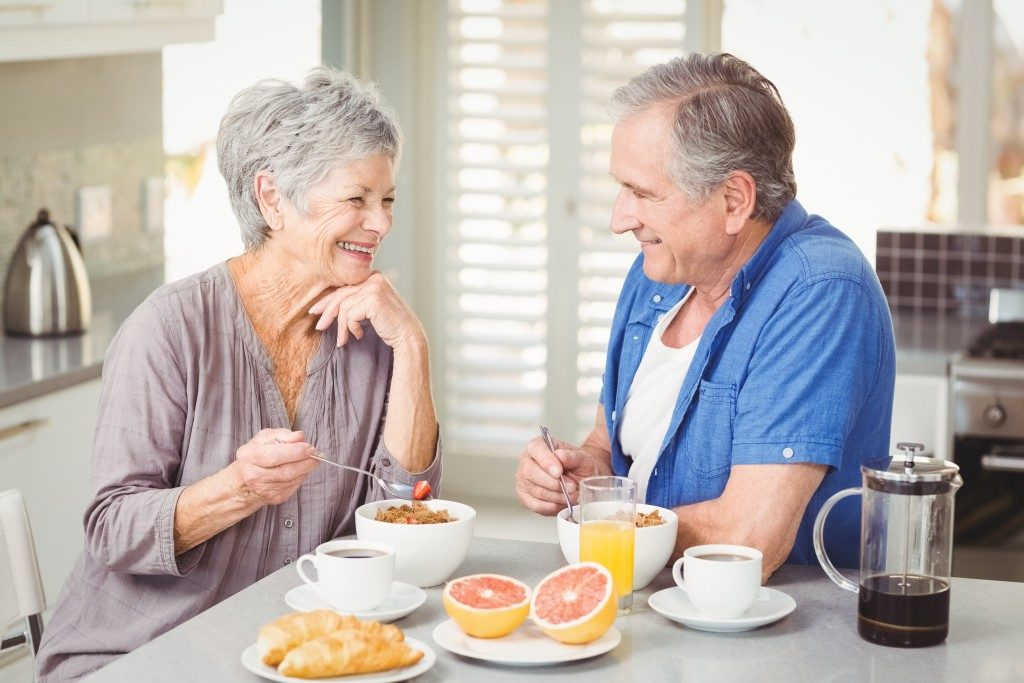 senior couple eating in their home