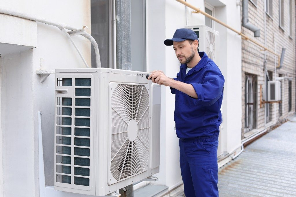 maintenance man checking on air ventilation system