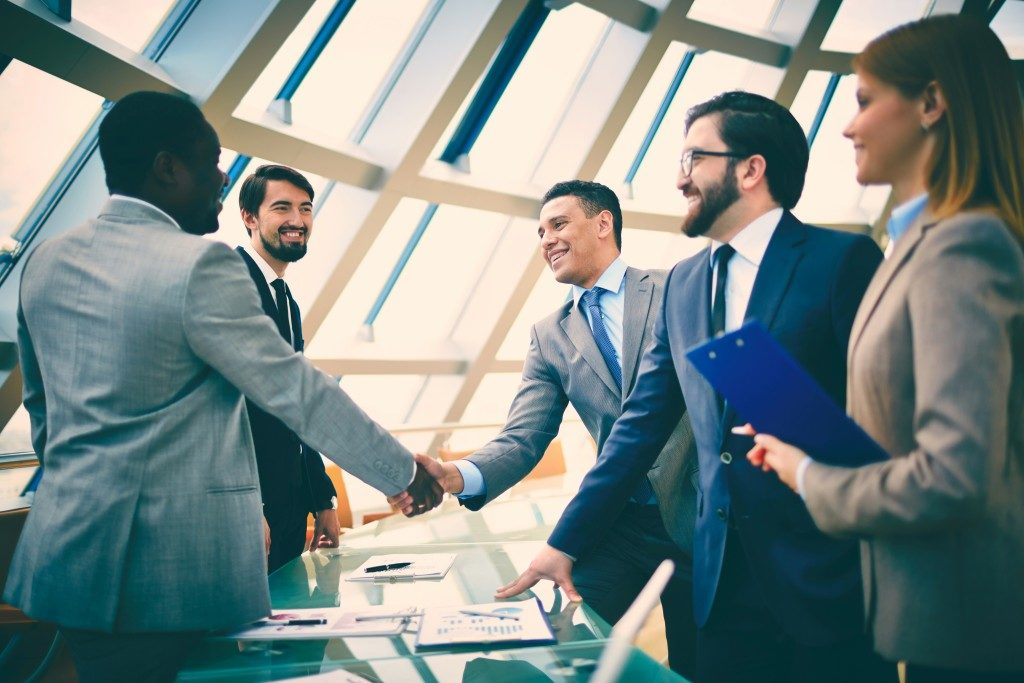 business officers shaking hands