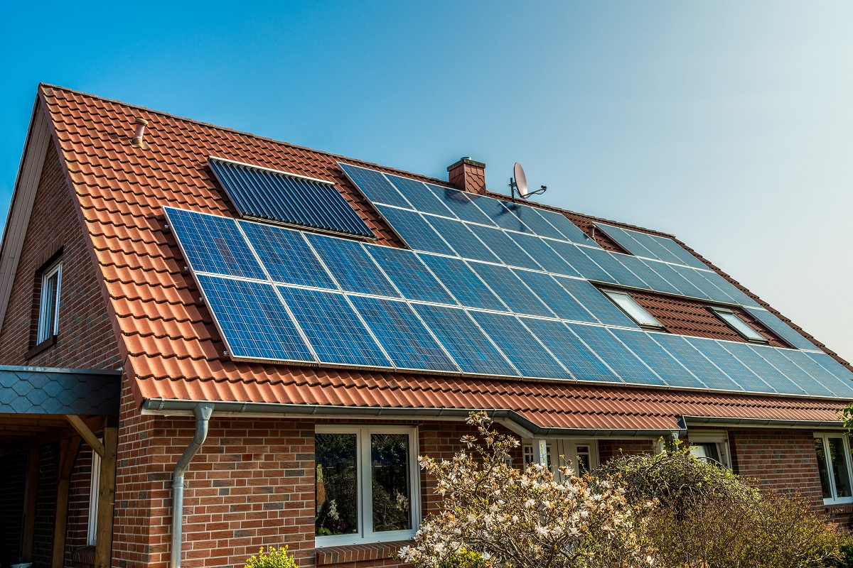 Brick home with solar panels on the roof