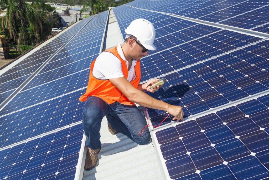 Technician checking the solar panels
