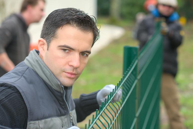 Men installing fence