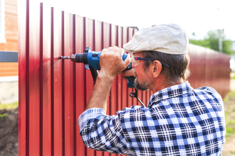 Man fixing the fence