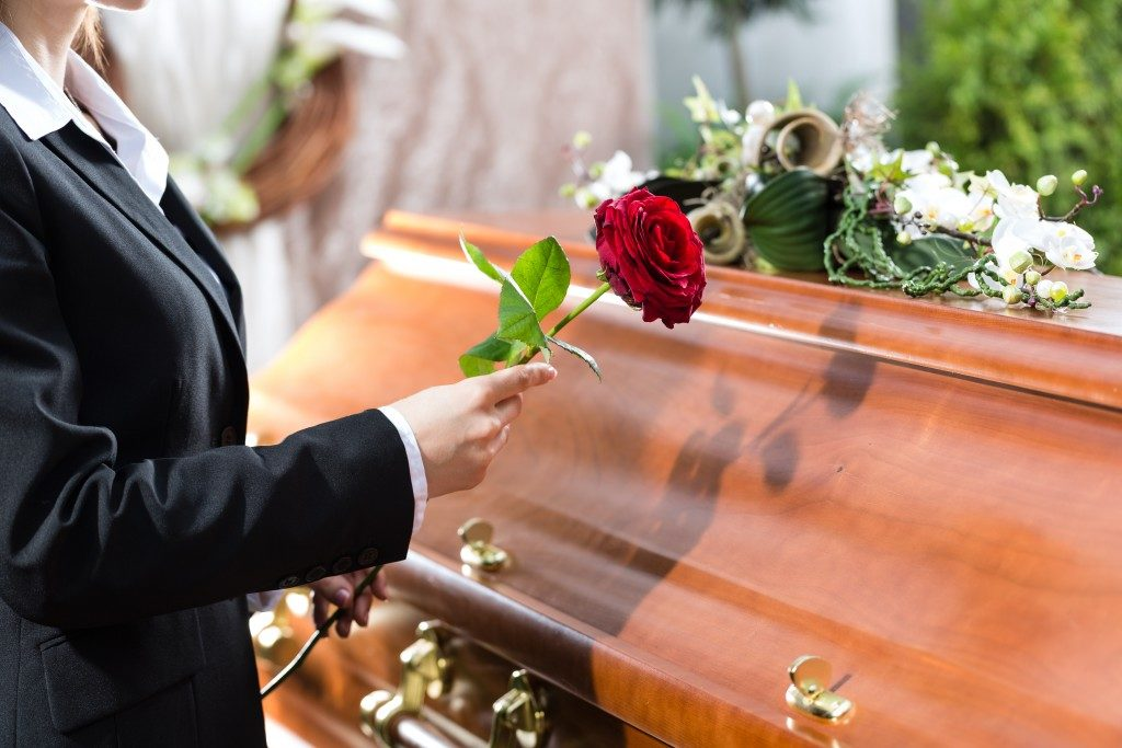 Woman holding a rose in funeral