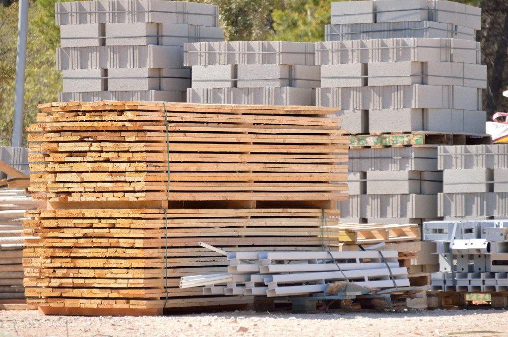 Construction materials stacked outdoors