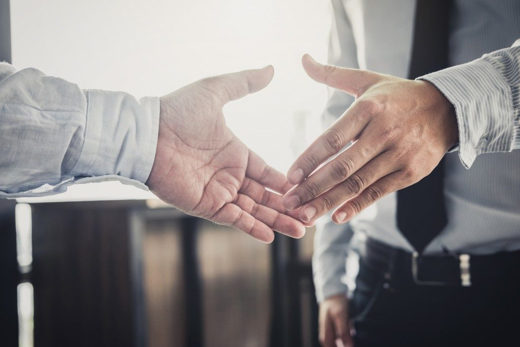 Businessmen shaking hands after negotiation