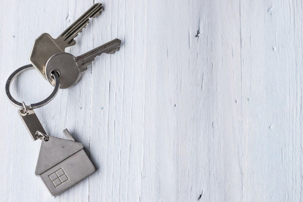 House keys on a white wooden surface