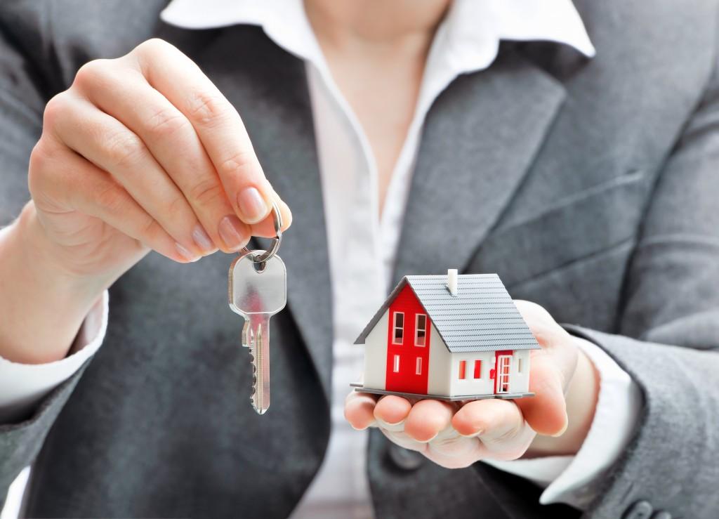 a key and a miniature home