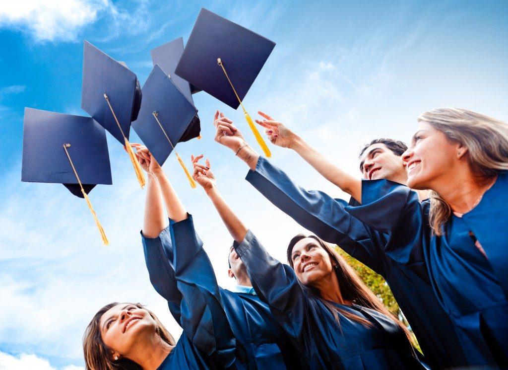 Graduates tossing their toga