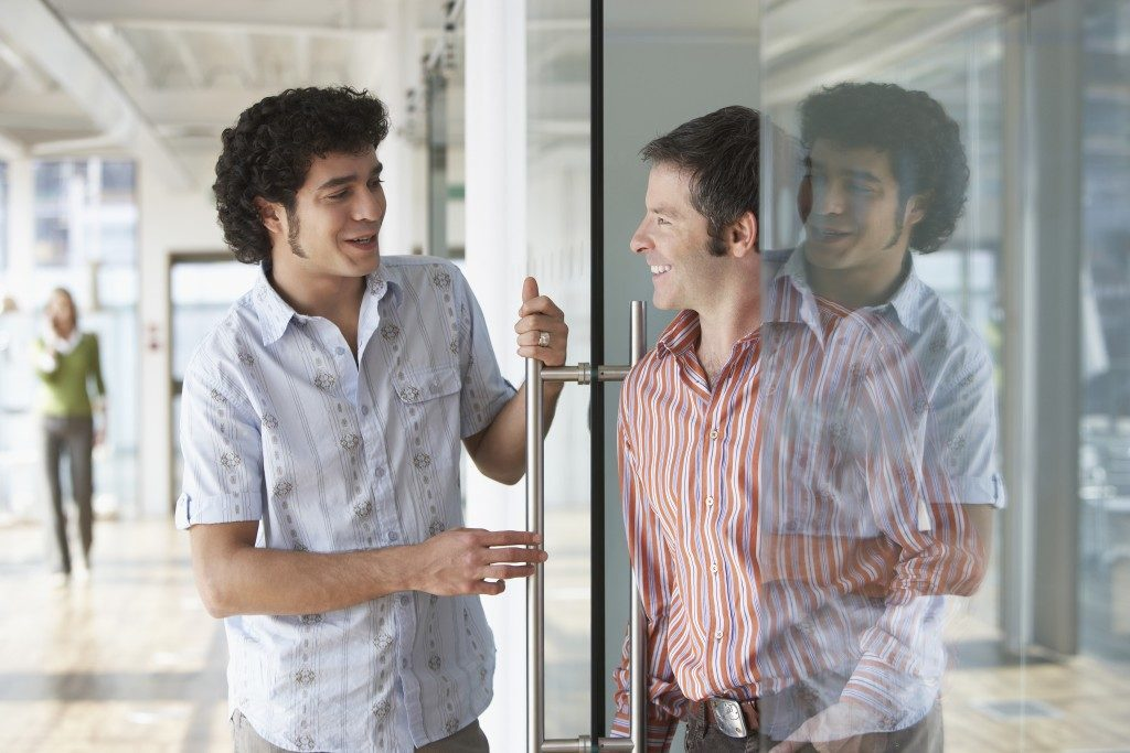 Employees talking near the glass door