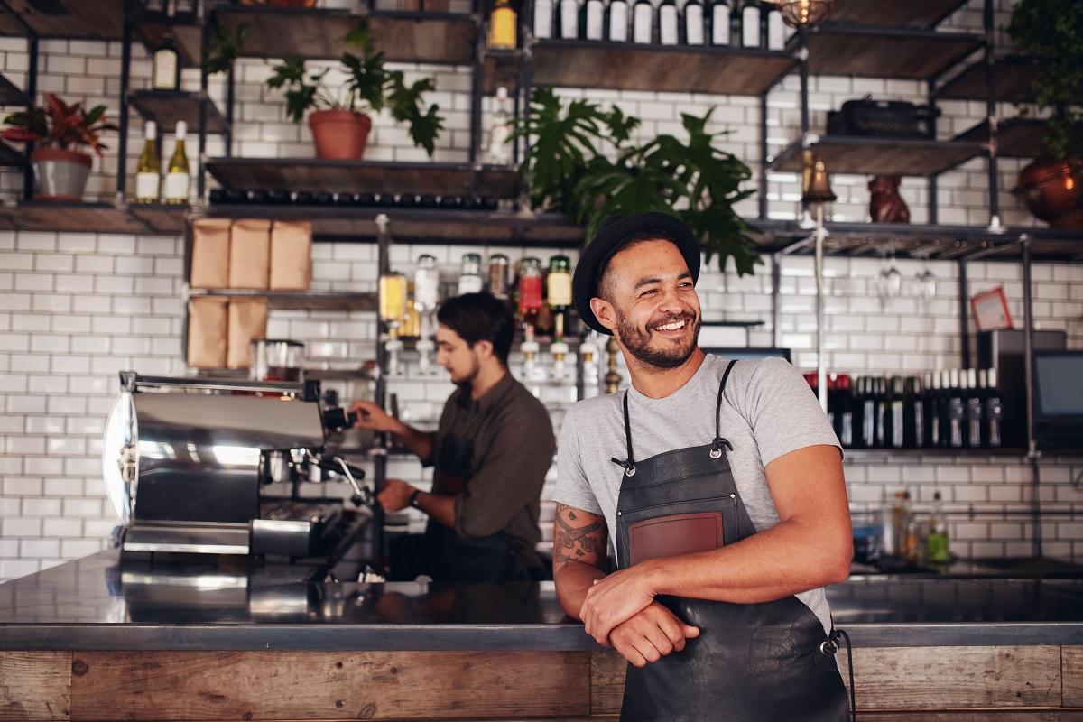 Entrepreneur leaning against the counter