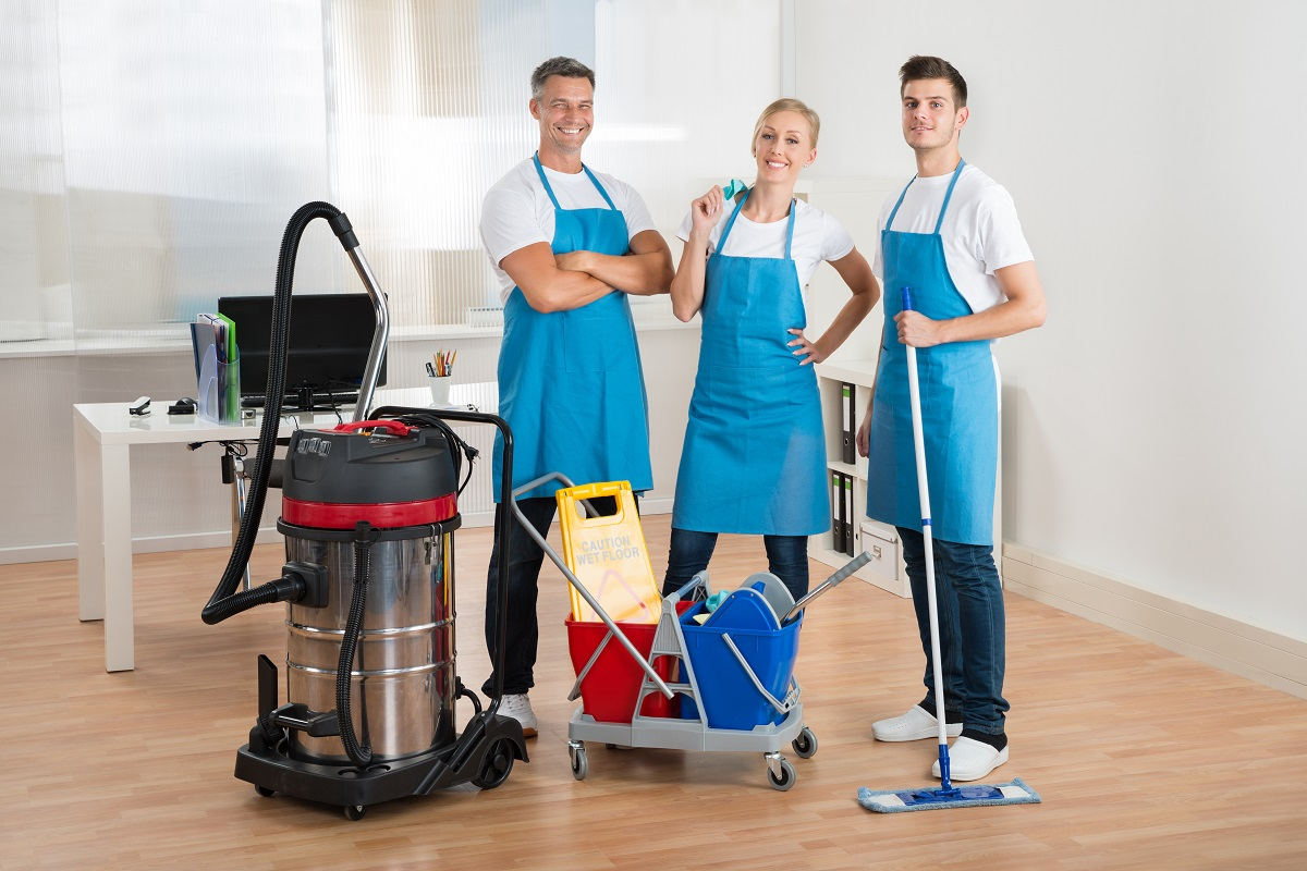Professional cleaners posing