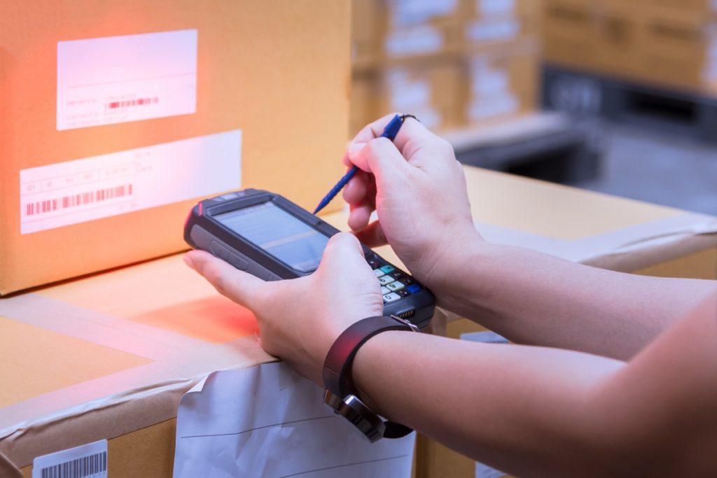 Supervisor scanning the inventory item