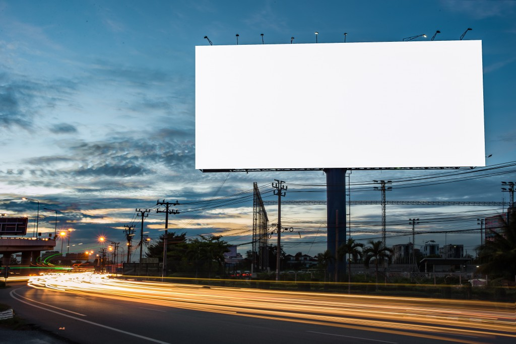 Blank billboard along the highway at night