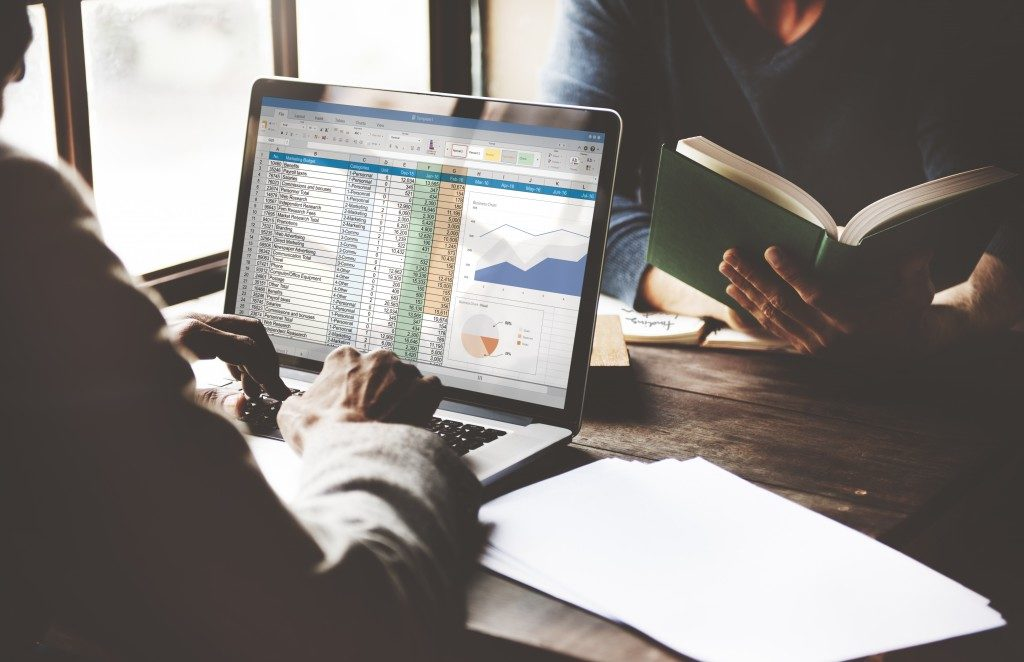 Team working on financial spreadsheet