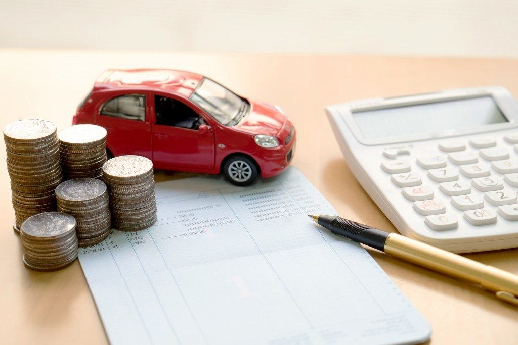 coins, bank book and small car