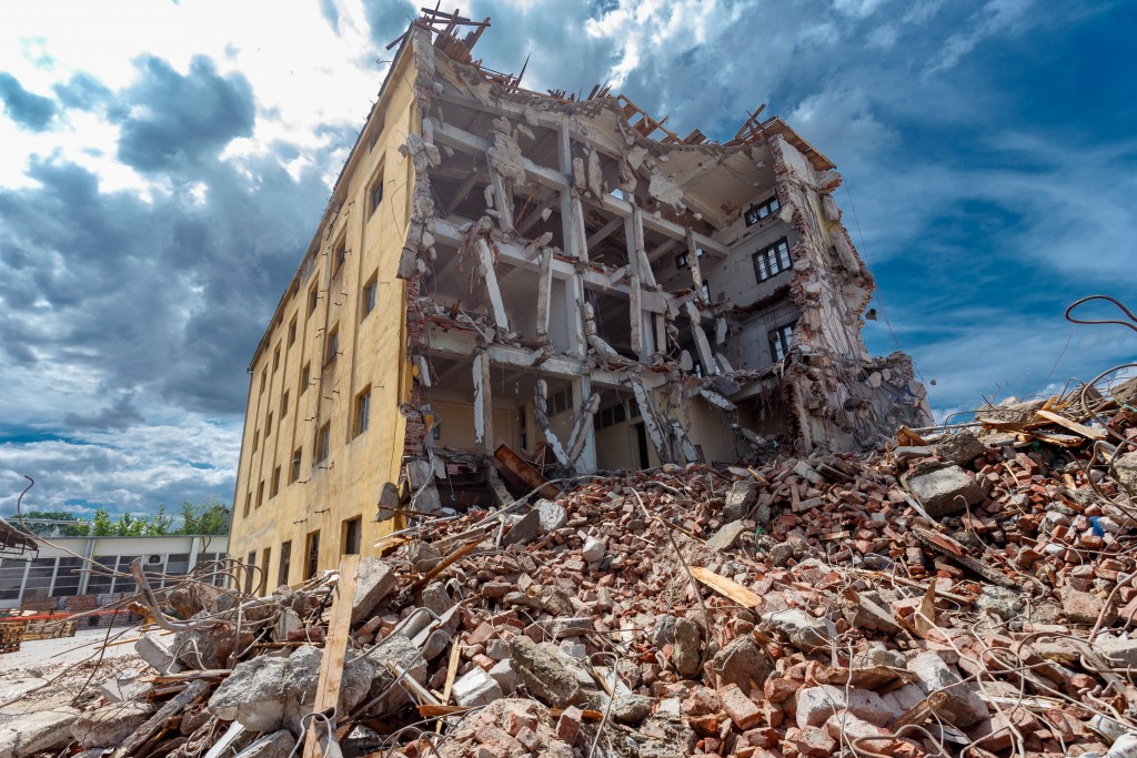 Demolished building surrounded with rubble and scrap
