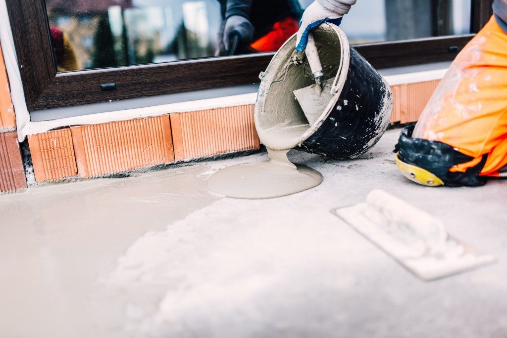 pouring of cement on top of concrete slab