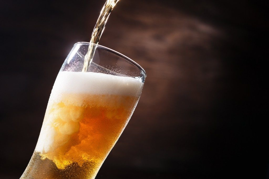 beer pouring down on glass