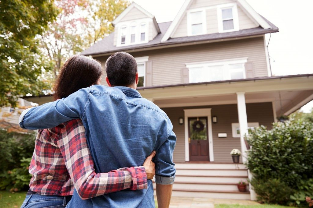 couple in front of their new home