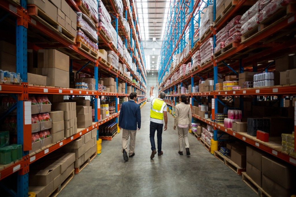 three men inside a huge warehouse