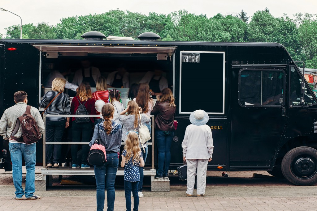 people buying from a mobile catering
