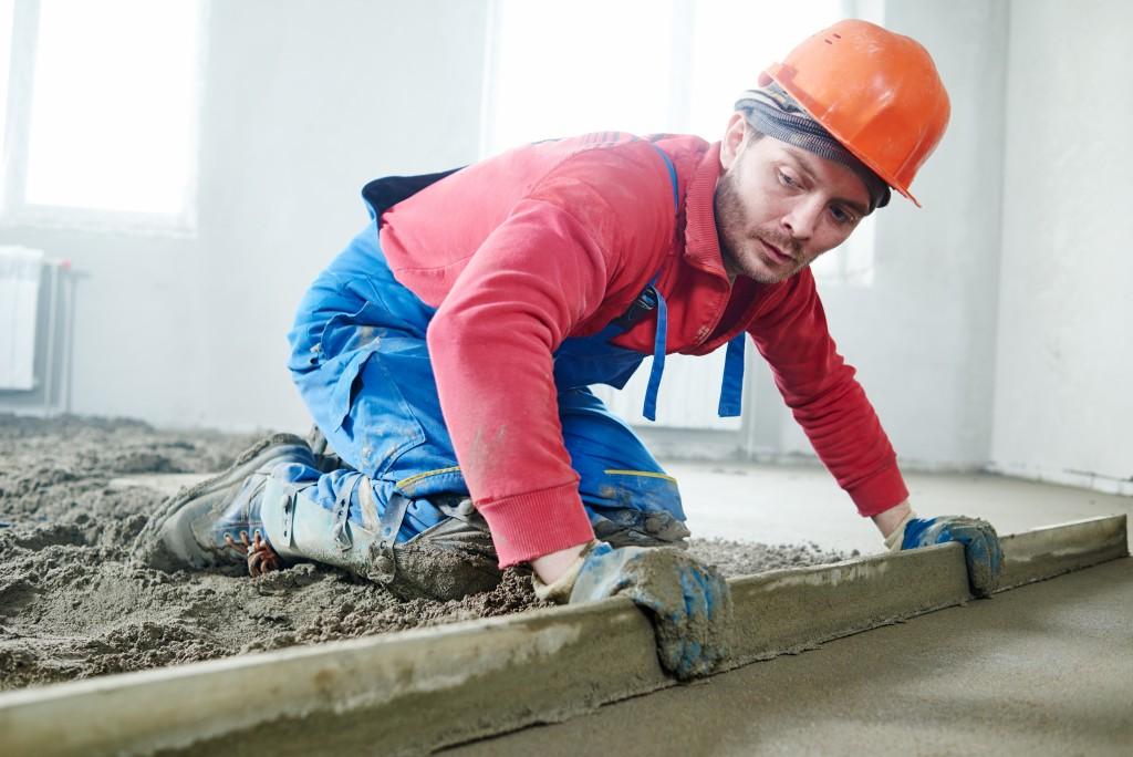 Man fixing the concrete floor