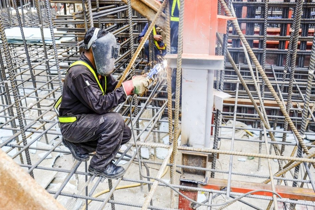 a construction worker welding metals of the building