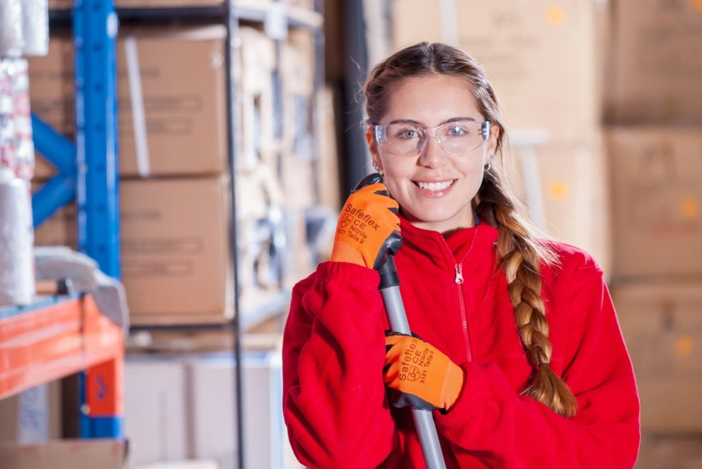 Woman wearing safety goggles at work