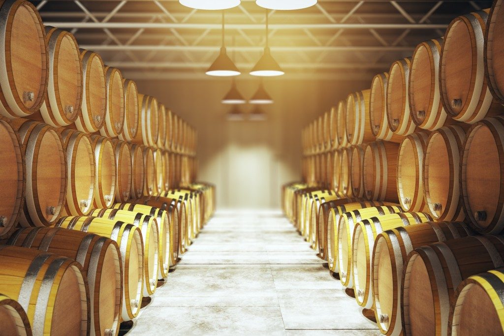 Numerous wooden barrels in winery