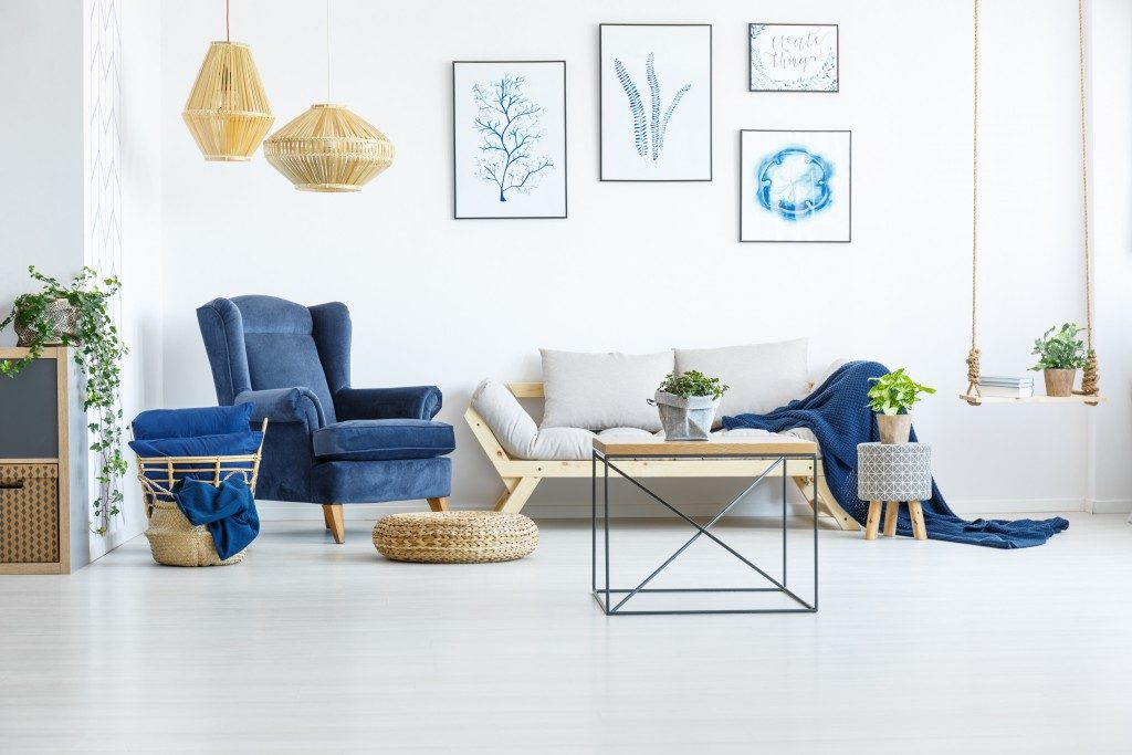 white living room with blue furniture