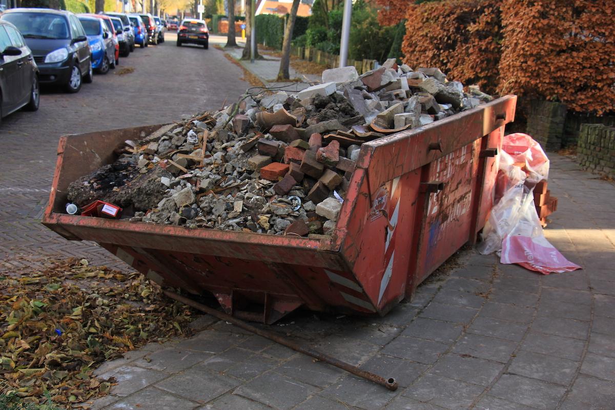 Garbage bin full of trash