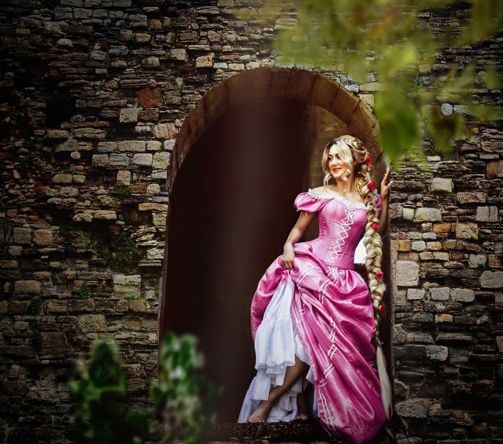 Rapunzel leaning on the window of a tower