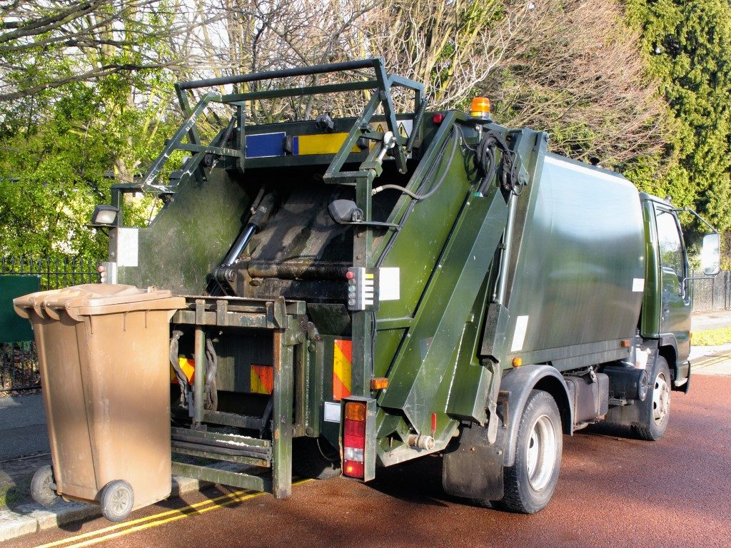 garbage truck picking up the bin