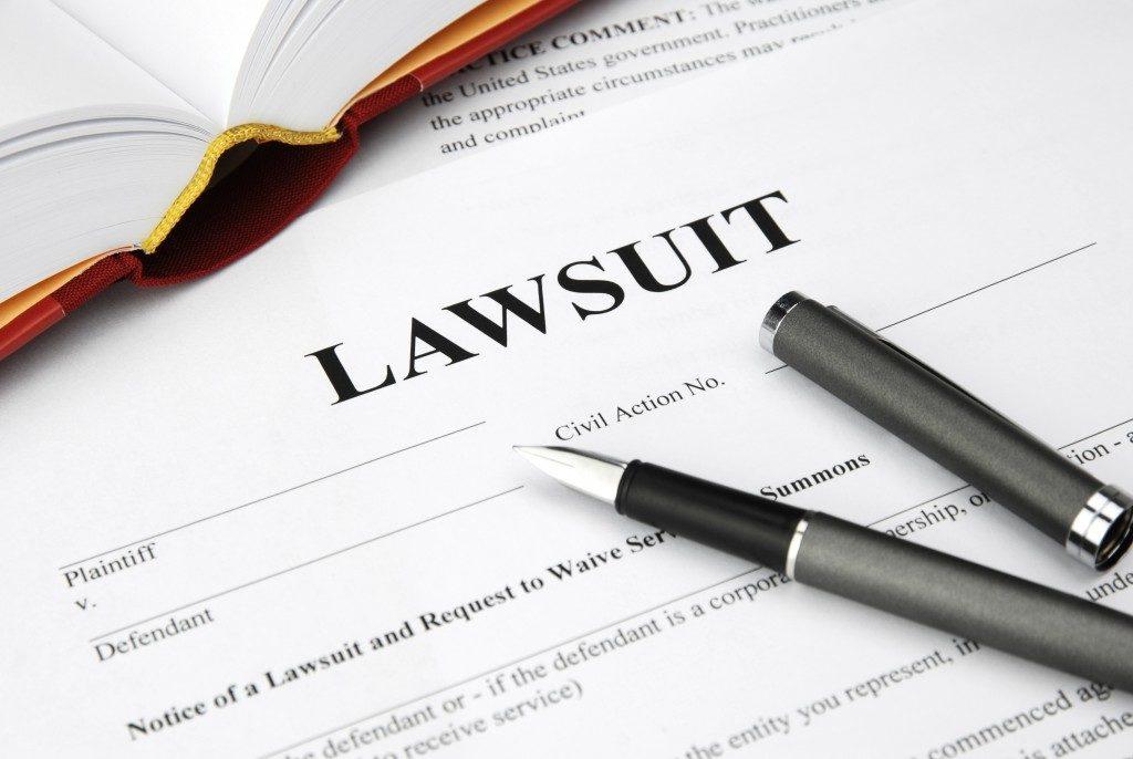 lawsuit form and pen