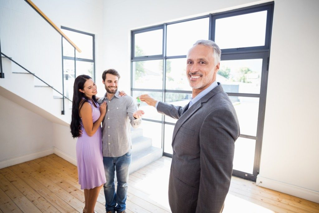 Realtor showing house to couple