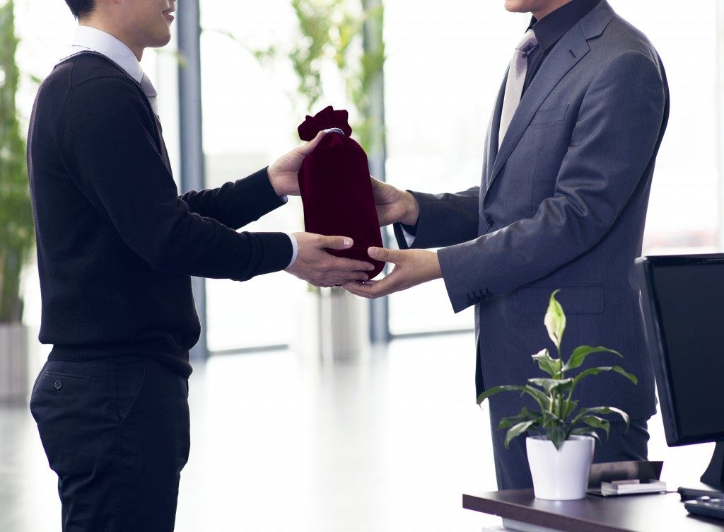 employee giving gift to his boss