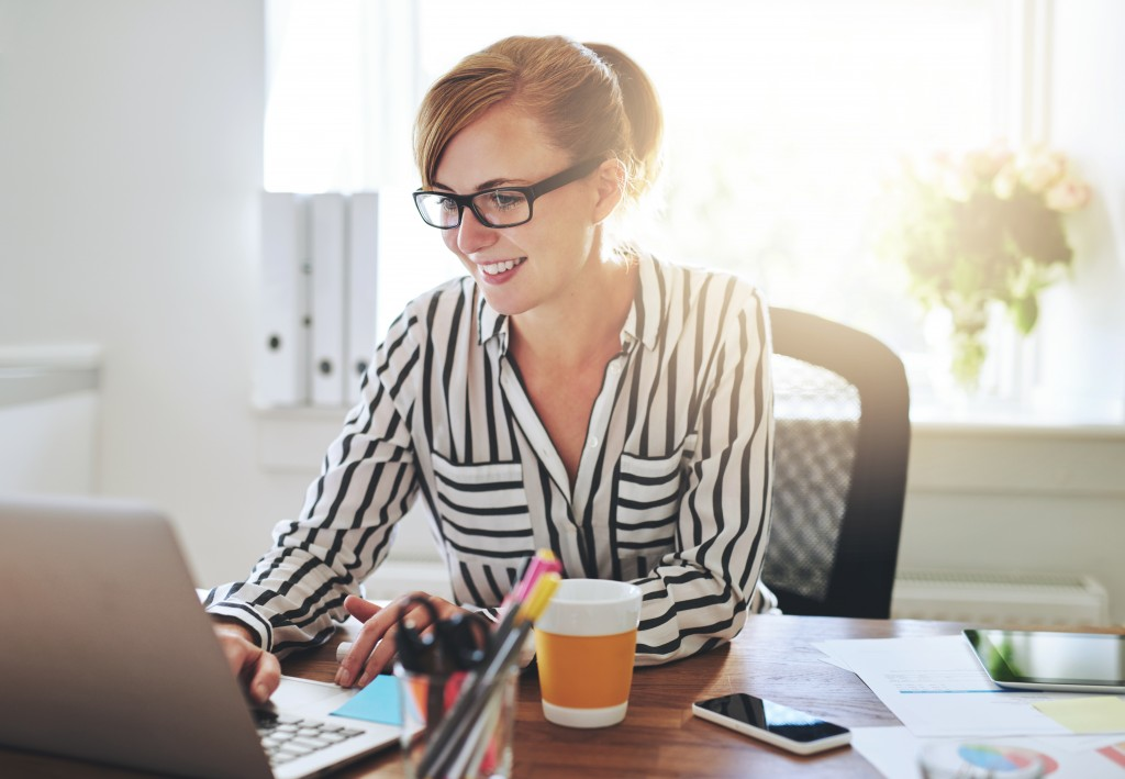 entrepreneur working on her laptop