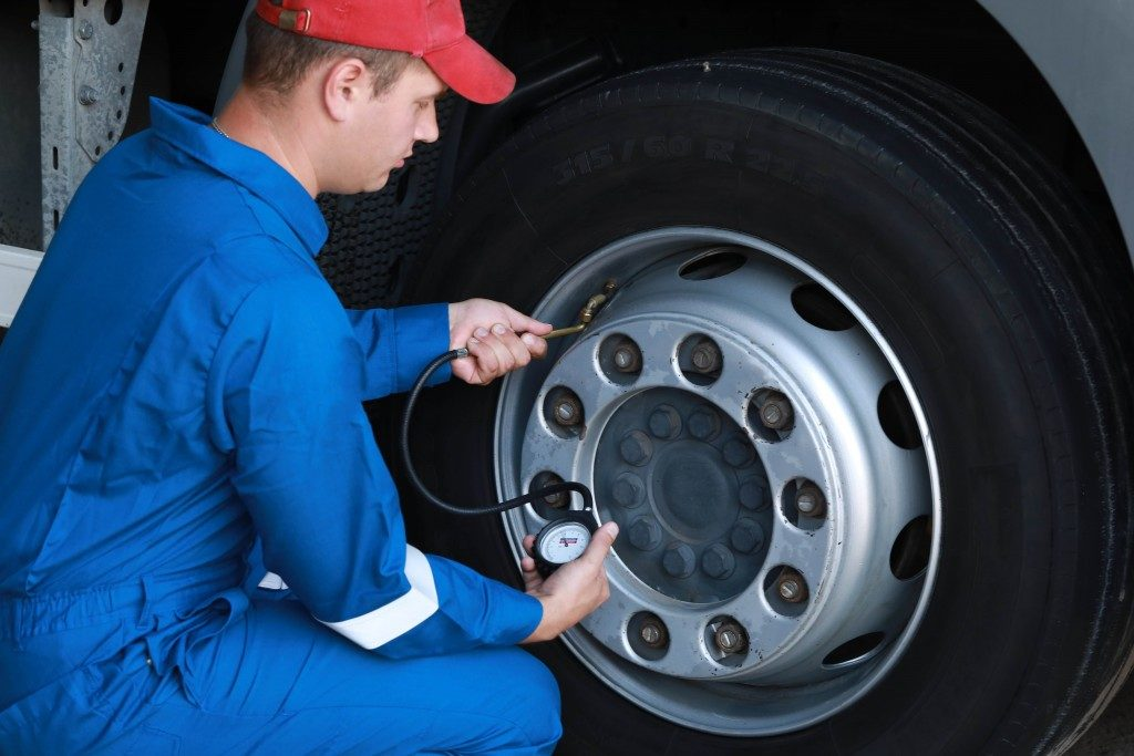 man checking tyres