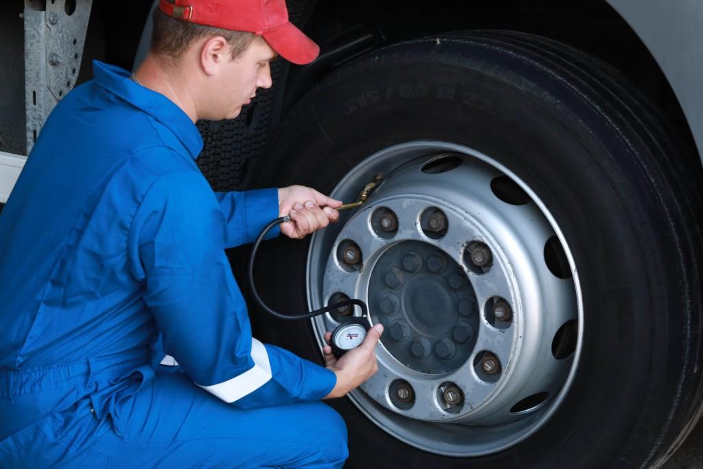 man checking tyres