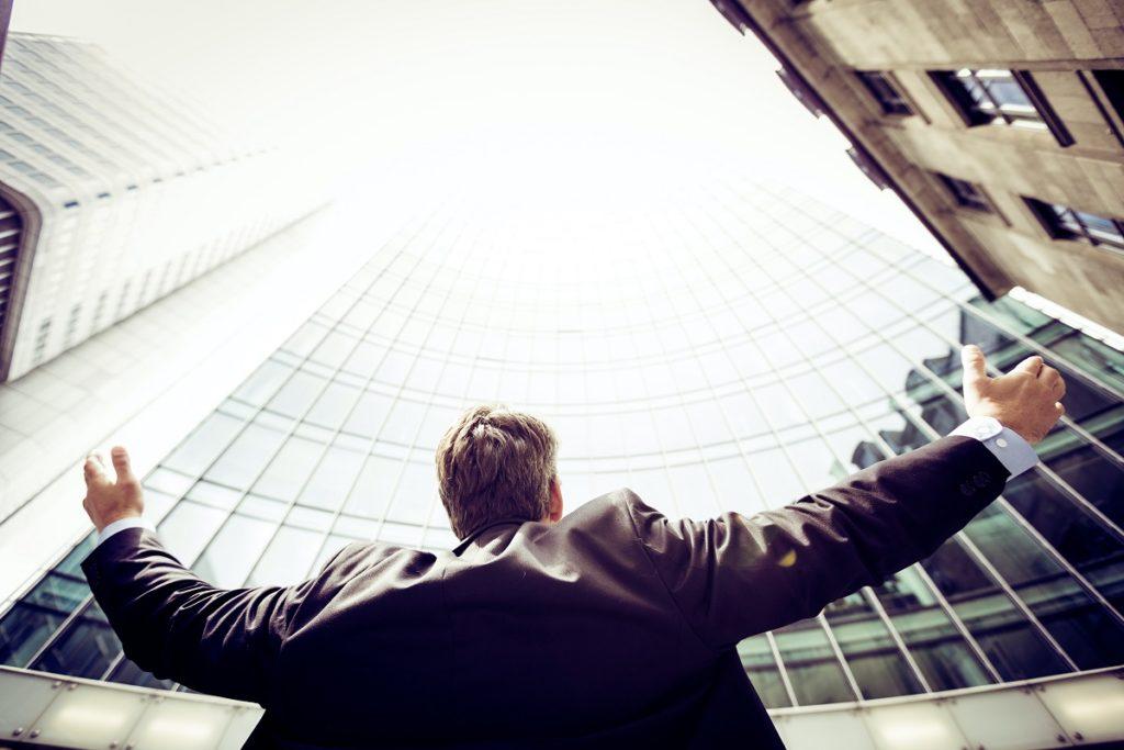 Man looking at skyscrapers