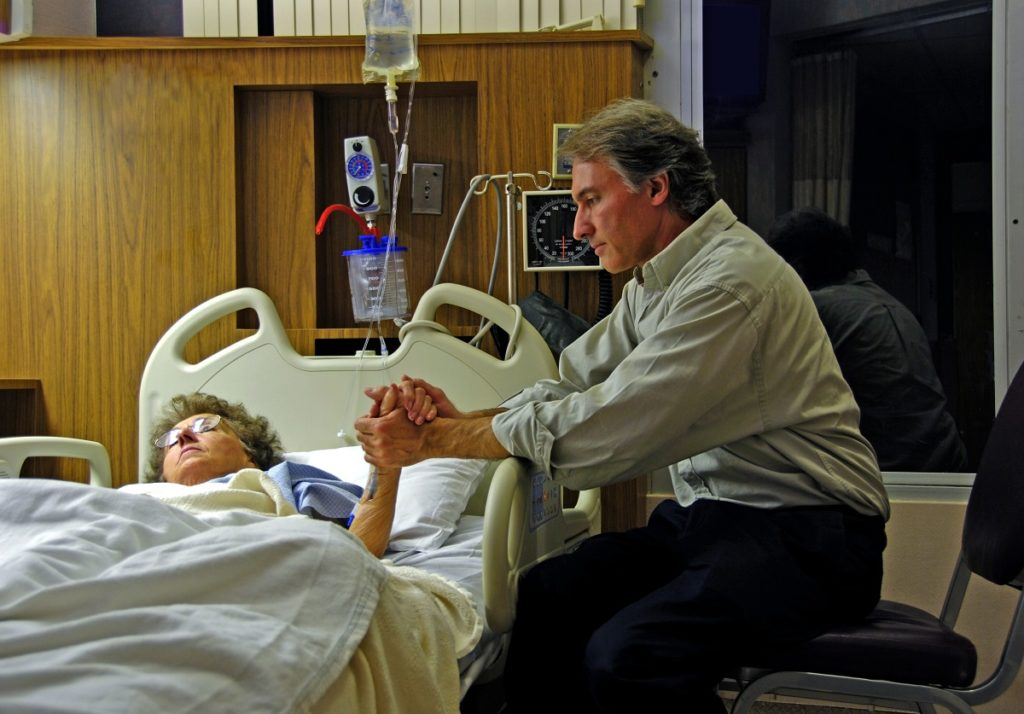couple holding hands in the hospital