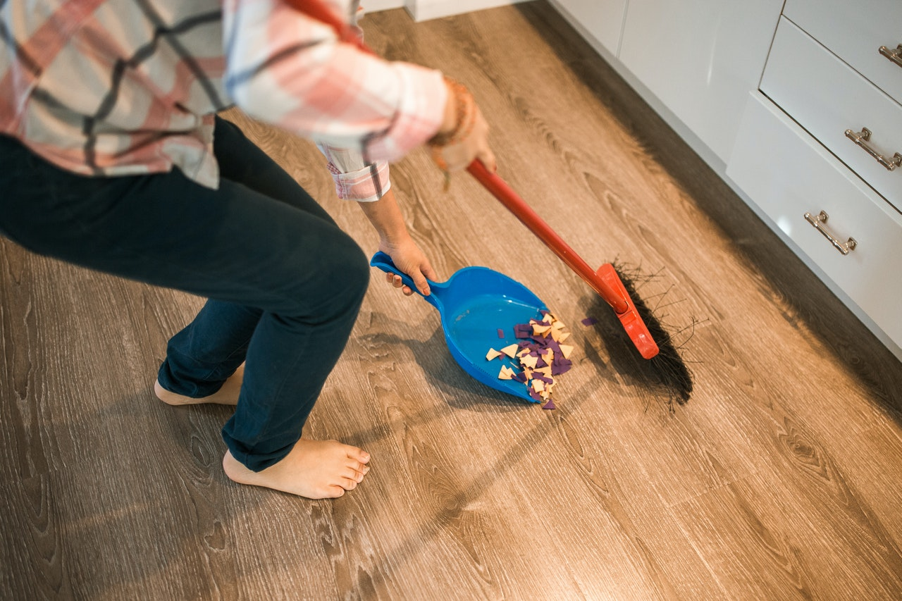 woman sweeping the floor
