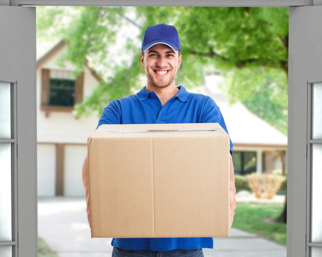 deliveryman holding a box