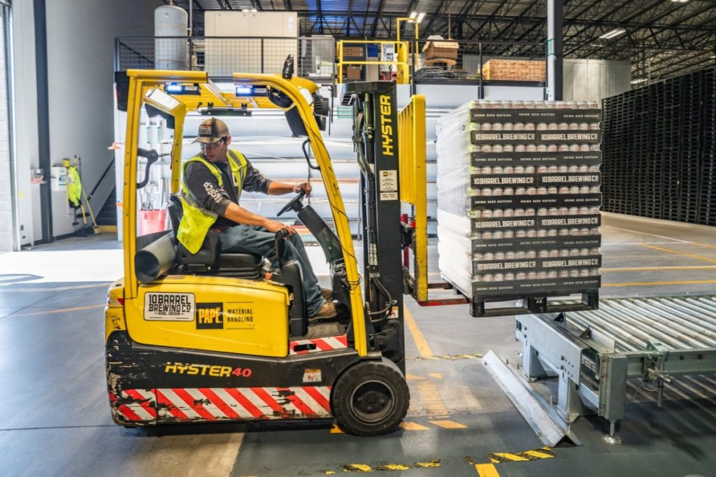 man using a forklift