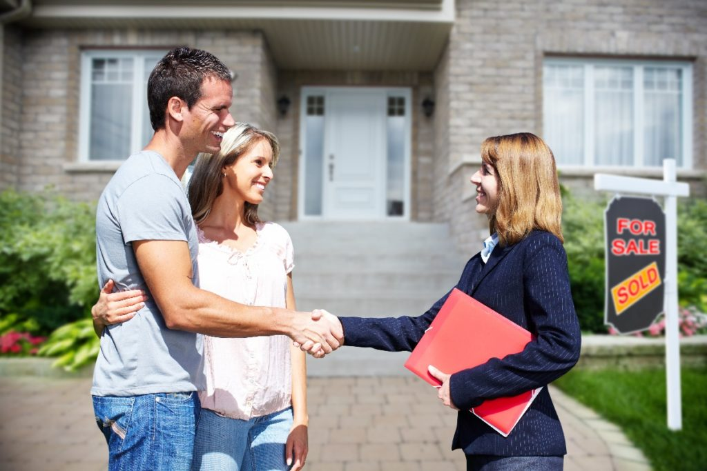 couple and real estate agent